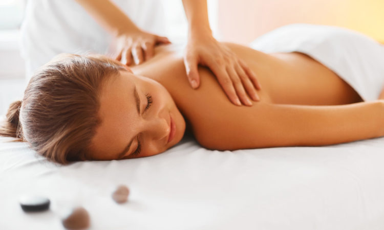 46406233 - spa woman. female enjoying relaxing back massage in cosmetology spa centre. body care, skin care, wellness, wellbeing, beauty treatment concept.